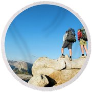 Hikers Stand On Rock On Sentinel Dome Round Beach Towel