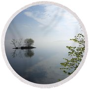 In The Distance On Mille Lacs Lake In Garrison Minnesota Round Beach Towel