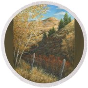 In The Shadow Of Belt Butte Round Beach Towel