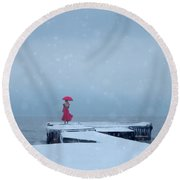 Lady In Red On Snowy Pier Round Beach Towel