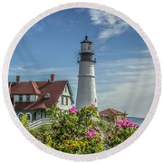 Lighthouse And Wild Roses Round Beach Towel by Jane Luxton