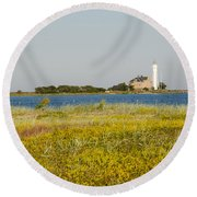 Lighthouse At Yellow Coast Round Beach Towel