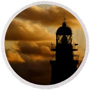 lighthouse dawn in the north coast of Menorca Round Beach Towel