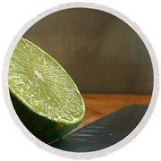 Round Beach Towel featuring the photograph Lime Blade by Joe Schofield