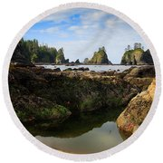 Low Tide At The Arches Round Beach Towel