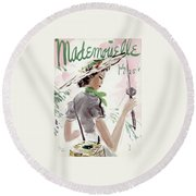 Mademoiselle Cover Featuring A Woman Holding Round Beach Towel by Helen Jameson Hall