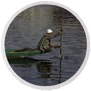 Man Plying A Wooden Boat On The Dal Lake Round Beach Towel