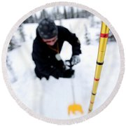 Man Probing And Shoveling For Snow Round Beach Towel