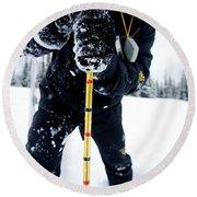 Man Probing For Snow Depth In Glacier Round Beach Towel