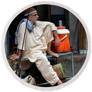 Man Sits And Relaxes In Lahore Walled City Pakistan Round Beach Towel