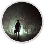 Round Beach Towel featuring the photograph Man Waiting In Fog With Case by Lee Avison