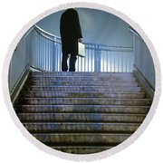 Round Beach Towel featuring the photograph Man With Case At Night On Stairs by Lee Avison