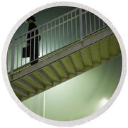 Round Beach Towel featuring the photograph Man With Case On Steps Nighttime by Lee Avison