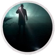 Round Beach Towel featuring the photograph Man With Flashlight  by Lee Avison
