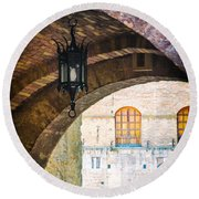 Round Beach Towel featuring the photograph Medieval Arches With Lamp by Silvia Ganora