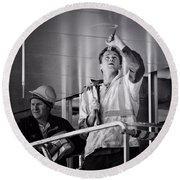 Round Beach Towel featuring the photograph Men At Work by Wallaroo Images