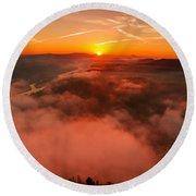 Misty Sunrise On The Lilienstein Round Beach Towel