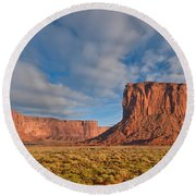 Mitchell Butte And Gray Whiskers In The Evening Light Round Beach Towel by Jeff Goulden
