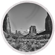 Round Beach Towel featuring the photograph Monument Valley 8 Bw by Ron White