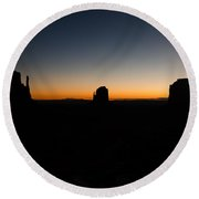 Round Beach Towel featuring the photograph Monument Valley Sunrise by Jeff Kolker