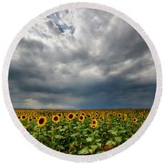 Round Beach Towel featuring the photograph Moody Skies Over The Sunflower Fields by Ronda Kimbrow