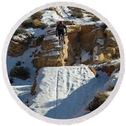 Mountain Biker Jumping With Snowy Round Beach Towel