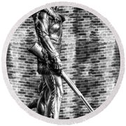 Mountaineer Statue With Black And White Brick Background Round Beach Towel