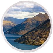 Round Beach Towel featuring the photograph Mountains Meet Lake by Stuart Litoff