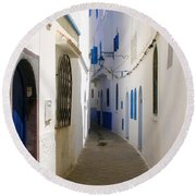 Round Beach Towel featuring the photograph Narrow Backstreet In The Medina Of Asilah On Northwest Tip Of Atlantic Coast Of Morocco by Ralph A  Ledergerber-Photography