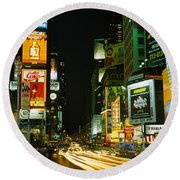 Neon Boards In A City Lit Up At Night Round Beach Towel