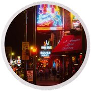 Neon Sign Lit Up At Night In A City Round Beach Towel