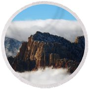 Nestled In The Clouds Round Beach Towel by Alan Socolik