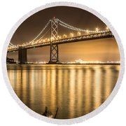 Night Descending On The Bay Bridge Round Beach Towel by Suzanne Luft