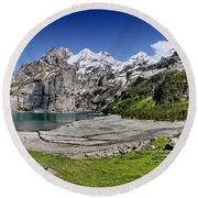Oeschinen Lake Round Beach Towel by Carsten Reisinger