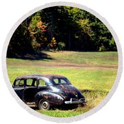 Old Car In A Meadow Round Beach Towel