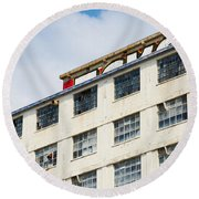 Old Factory Under A Clear Blue Sky Round Beach Towel by Nick  Biemans