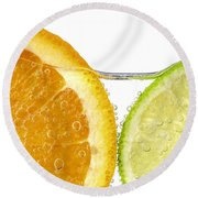Orange And Lime Slices In Water Round Beach Towel by Elena Elisseeva
