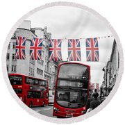 Round Beach Towel featuring the photograph Oxford Street Flags by Matt Malloy