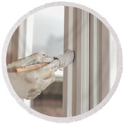 Painting A Window With White Round Beach Towel