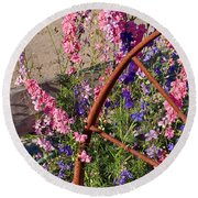 Pastel Colored Larkspur Flowers With Rusty Wagon Wheel Art Prints Round Beach Towel