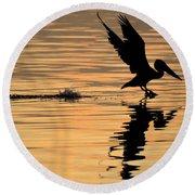 Pelican At Sunrise Round Beach Towel