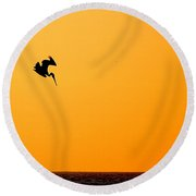 Pelican Diving At Sunset Round Beach Towel