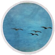 Pelicans In Flight Round Beach Towel