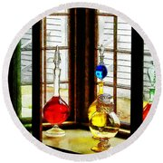 Round Beach Towel featuring the photograph Pharmacist - Colorful Bottles In Drug Store Window by Susan Savad
