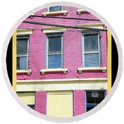 Round Beach Towel featuring the photograph Pink Yellow Blue Building by Kathy Barney