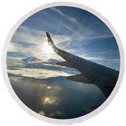 Plane Flies Over The Pacific Ocean Round Beach Towel