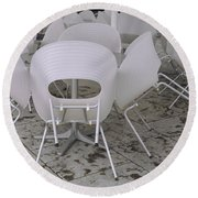 Plastic Chairs Around Tables In A Round Beach Towel