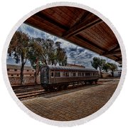 Round Beach Towel featuring the photograph platform view of the first railway station of Tel Aviv by Ron Shoshani