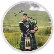 Playing Bagpiper In Highlands Round Beach Towel