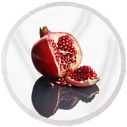 Pomegranate Opened Up On Reflective Surface Round Beach Towel